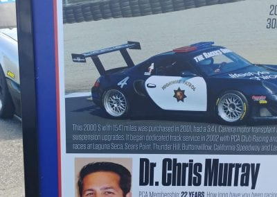 Tony's long time friend and Racing competitor Dr Chris Murray with his Boxster Police Race Car